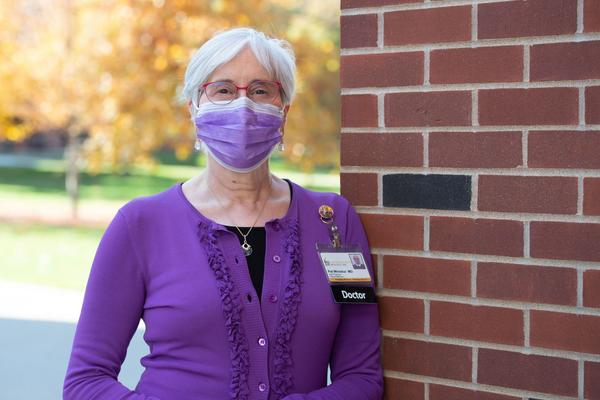 Pat Winokur, MD, executive dean of the University of Iowa Carver College of Medicine, standing outdoors, wearing face mask