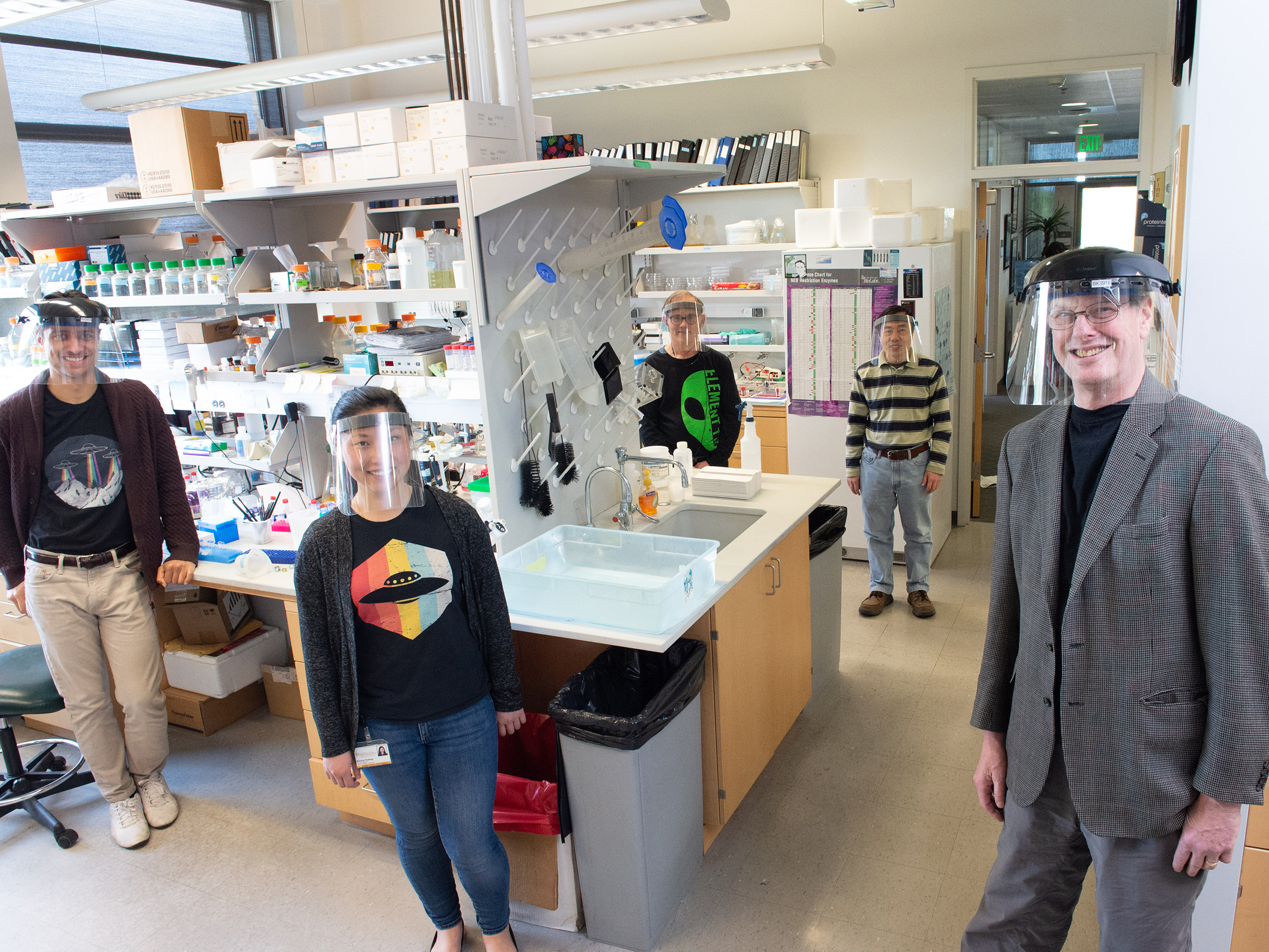 Val Sheffield (right), with members of his research laboratory (from left): Calvin Carter, Sunny Huang, Charles Searby, and Qihong Zhang.